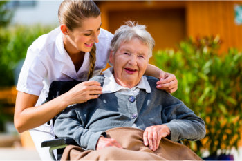 happy elderly woman with her caregiver